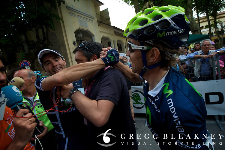 Francisco Ventoso celebrates with Arroyo Duran after his stage 6 victory.  This TV reporter managed to get his wires tangled in the middle of Movistar's moment.