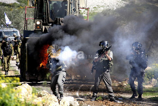 Israeli soldiers fire tear gas canisters at Palestinian protestors during a demonstration against the expropriation of Palestinian land by Israel in the village of Kafr Qaddum, near Nablus in the occupied West Bank on March 9, 2012. Photo by Wagdi Eshtayah