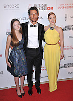 Matthew McConaughey with Jessica Chastain (right) &amp; Mackenzie Foy at the 28th Annual American Cinematheque Award Gala honoring Matthew McConaughey at the Beverly Hilton Hotel.<br /> October 21, 2014  Beverly Hills, CA<br /> Picture: Paul Smith / Featureflash