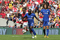 N'Golo Kante of Chelsea tries to outpace Arsenal's Danny Welbeck during Arsenal vs Chelsea, FA Community Shield Football at Wembley Stadium on 6th August 2017