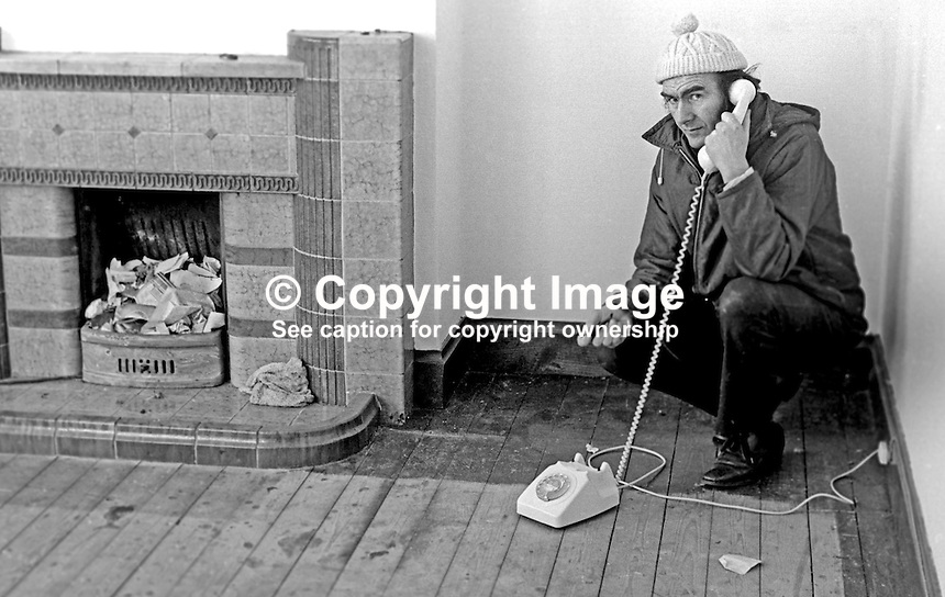 Rev Joseph Parker, about to emigrate to Canada, with wife, Dorothy, and their son, Roger, and daughter, Karen, makes last minute telephone calls in their almost empty Belfast home. Rev Parker founded the Witness for Peace Movement following the death of his son in a Provisional IRA  explosion. Taken 28th January 1975. Ref: 197501280054b.<br />