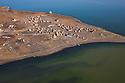 Kenya, Rift Valley, tribal village on peninsula at Lake Turkana