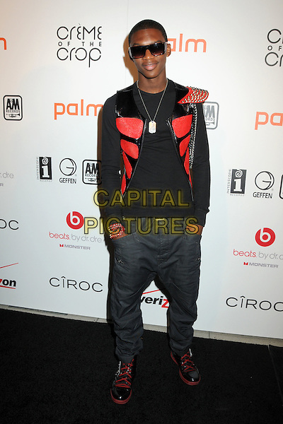 "MISHON RATLIFF.Interscope Geffen A&M Records 4th Annual ""Creme of the Crop"" Post BET Awards 2010 Celebration held at Mr. Chow Restaurant,  Beverly Hills, California, USA, 27th June 2010..full length black red shoulder wing studded silver studs hands in pockets jeans trainers patent .CAP/ADM/BP.©Byron Purvis/AdMedia/Capital Pictures."