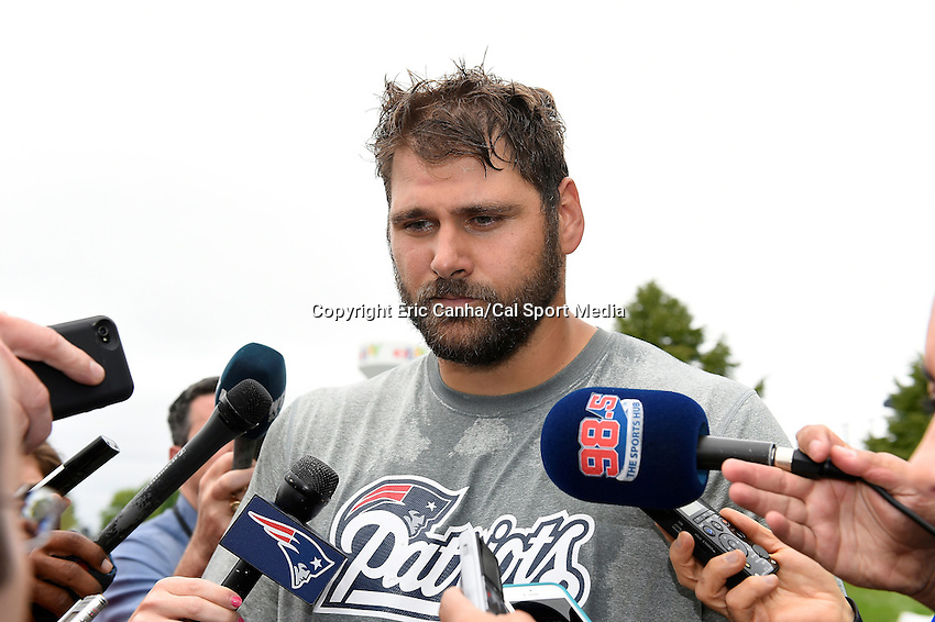 June 12, 2014 - Foxborough, Massachusetts, U.S. - New England Patriots tackle Sebastian Vollmer (76)  takes questions from the media at the team's organized team activity at Gillette Stadium in Foxborough, Massachusetts. Eric Canha/CSM