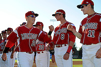 Batavia Muckdogs third baseman Blake Barber #23 fist bumps Ryan Aper #11 during introductions before a game against the Auburn Doubledays on June 18, 2013 at Dwyer Stadium in Batavia, New York.  Batavia defeated Auburn 10-2.  (Mike Janes/Four Seam Images)
