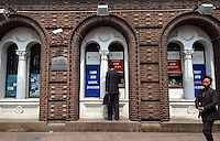 A customer uses the ATM at the Bank of Shanghai, Shanghai, China. .