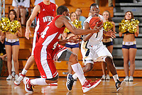 28 January 2012:  FIU guard Deric Hill (1) pursues a loose ball as it is recovered by WKU guard-forward George Fant (44) in the second half as the Western Kentucky University Hilltoppers defeated the FIU Golden Panthers, 61-51, at the U.S. Century Bank Arena in Miami, Florida.