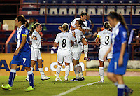 USA team celebrates at the 2010 CONCACAF Women's World Cup Qualifying tournament held at Estadio Quintana Roo in Cancun, Mexico.
