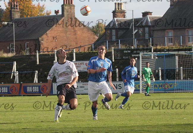 Ryan Conroy keeps an eye on the ball with Kallum Higginbotham