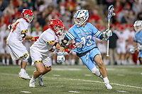 College Park, MD - April 27, 2019: John Hopkins Bluejays attack Kyle Marr (13) fights off Maryland Terrapins midfielder Roman Puglise (8) during the game between John Hopkins and Maryland at  Capital One Field at Maryland Stadium in College Park, MD.  (Photo by Elliott Brown/Media Images International)