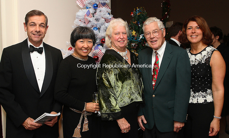 """WATERBURY, CT  DECEMBER 2006-120106MK34  (from left) Ned and Sun Williams,  Dr. Roberta Massey, Chair of the Gala, Walter Torrance and Sandra Vigliotti at the Matattuck Museum Arts and History Center Friday evening. The annual Festival of Trees wrapped up in a Gala which featured """"Silver Bells in the City"""" as its theme paying homage to the sights and sounds of Hollywood. Michael Kabelka / Republican-American ((from left) Ned and Sun Williams,  Dr. Roberta Massey, Chair of the Gala, Walter Torrance and Sandra VigliottiCQ)"""