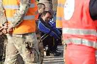 Alcune persone attendo di fronte le macerie dell'azienda Haemotronic di Medolla, rasa al suolo dalla scossa di terremoto di ieri 29 maggio 2012, per il riconoscimento del corpo di un operaio disperso recuperato oggi 30 Maggio 2012. ONE SHOT / INSIDEFOTO