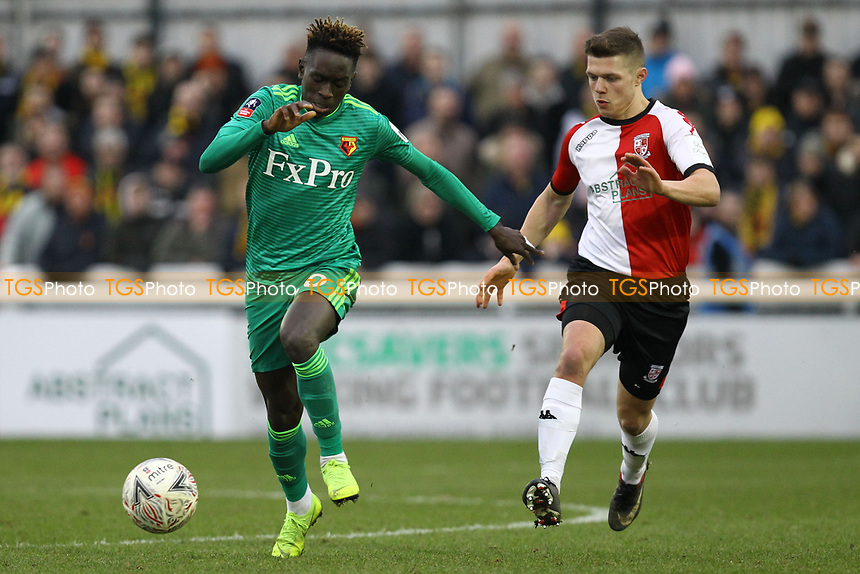 Domingos Quina of Watford and Paul Hodges of Woking during Woking vs Watford, Emirates FA Cup Football at The Laithwaite Community Stadium on 6th January 2019