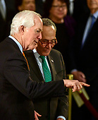 United States Senator John Cornyn (Republican of Texas), left, and United States Senate Minority Leader Chuck Schumer (Democrat of New York), right, converse prior to the ceremony honoring former United States President George H.W. Bush, who will Lie in State in the Rotunda of the US Capitol on Monday, December 3, 2018.<br /> Credit: Ron Sachs / CNP<br /> (RESTRICTION: NO New York or New Jersey Newspapers or newspapers within a 75 mile radius of New York City)