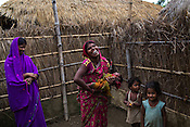 Srikanthi Devi's shares a light moment with her family in their courtyard of their house in Ramgarwa village in Raxaul district in Bihar, India.