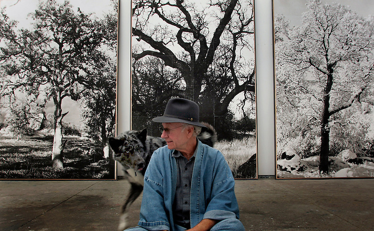 Artist Joe Goode with his dog, Pollack, at his studio in Los Angeles. In the late 1970s, Goode moved to a small town in northern California to paint. His series burned in a fire, and he was left with only the photo slides. In his new show, Ashes, he has taken these photos of this lost art, and painted on top of them, to create a new series.