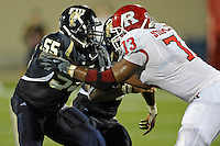 11 September 2010:  FIU linebacker Gregory Hickman (55) battles Rutgers offensive linesman Desmond Stapleton (73) at the line of scrimmage in the third quarter as the Rutgers Scarlet Knights defeated the FIU Golden Panthers, 19-14, at FIU Stadium in Miami, Florida.