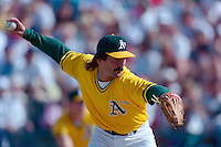 PHOENIX, AZ - Dennis Eckersley of the Oakland Athletics pitches during a spring training game against the San Francisco Giants at Phoenix Municipal Stadium in Phoenix, Arizona in 1992. Photo by Brad Mangin