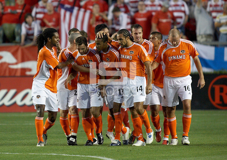 Houston Dynamo teammates congratulate Ricardo Clark (13) after Clark's unassisted goal at Robertson Stadium in Houston, TX on Saturday May 6, 2006. The Houston Dynamo defeated FC Dallas 4-3.