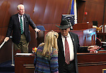 Nevada Assembly Republicans, from left, John Hambrick, Jill Dickman and Jim Wheeler work on the Assembly floor at the Legislative Building in Carson City, Nev., on Friday, May 22, 2015. <br /> Photo by Cathleen Allison