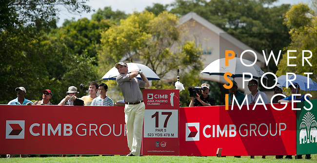Mark Wilson tees off at the seventeenth during Round 2 of the CIMB Asia Pacific Classic 2011.  Photo © Raf Sanchez / PSI for Carbon Worldwide