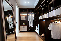 BNPS.co.uk (01202 558833)<br /> Pic: Savills/BNPS<br /> <br /> Walk in wardrobe.<br /> <br /> Fairway to Heaven - Hills End has been described as 'a fabulous new masterpiece'. <br /> <br /> This breathtaking brand new mansion only a pitching wedge from one the most exclusive golf clubs in the country has emerged for sale for a whopping £22m.<br /> <br /> Hills End nestles within the prestigious Sunningdale estate in Surrey, home of the £4,000 a year Sunningdale Golf Club which dates back to 1900 and has hosted the Women's British Open and the Senior Open Championship.<br /> <br /> The newly-built property sits on a 1.75 acre plot  boasting six bedrooms, eight reception areas, a swimming pool complex with spa, sauna and yoga rooms along with a large cinema. and walk in wardrobes.<br /> <br /> The incredible Palladian style home is on the market with estate agents Savills who describe it as 'a fabulous new masterpiece'...that comes with a whopping £22 million price tag.