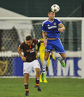 Gary Cahill (24) of Chelsea FC heads the ball against Francesco Totti (10) of AS Roma.  Chelsea FC defeated AS Roma 2-1, during an international friendly , at RFK Stadium, Saturday August 10 , 2013.