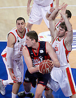 Caja Laboral Baskonia's Tibor Pleiss (c) and CAI Zaragoza's Pablo Aguilar (l) and Jon Stefansson during Spanish Basketball King's Cup match.February 07,2013. (ALTERPHOTOS/Acero)