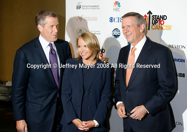 HOLLYWOOD, CA. - September 05: (L-R) NBC Nightly News anchor Brian Williams, CBS Evening News anchor Katie Couric and ABC World News Tonight anchor Charles Gibson arrive at Stand Up For Cancer at The Kodak Theatre on September 5, 2008 in Hollywood, California.