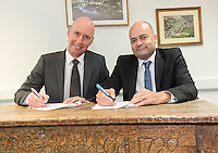 Malcolm Kelly, (left) Head of Anthony Gell High School, Wirksworth signs the agreement with Steve Radford, Director of Griffe Grange Wind Farm on a table gifted to the school in 1722 by Mrs Temperance Gell