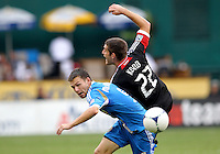 WASHINGTON, D.C. - AUGUST 19, 2012:  Chris Kolb (22) of DC United crashes into Jack McInerney (9) of the Philadelphia Union during an MLS match at RFK Stadium, in Washington DC, on August 19. The game ended in a 1-1 tie.