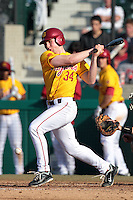 Kevin Swick (34) of the USC Trojans bats against the Jacksonville Dolphins at Dedeaux Field on February 19, 2012 in Los Angeles,California. USC defeated Jacksonville 4-3.(Larry Goren/Four Seam Images)