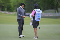 Tony Romo (a) (USA) discusses his putt with his bundled up caddie during round 2 of the AT&T Byron Nelson, Trinity Forest Golf Club, Dallas, Texas, USA. 5/10/2019.<br /> Picture: Golffile | Ken Murray<br /> <br /> <br /> All photo usage must carry mandatory copyright credit (© Golffile | Ken Murray)