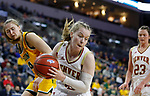 SIOUX FALLS, SD - MARCH 8: Claire Gritt #12 of the Denver Pioneers grabs the rebound against the North Dakota State Bison at the 2020 Summit League Basketball Championship in Sioux Falls, SD. (Photo by Richard Carlson/Inertia)