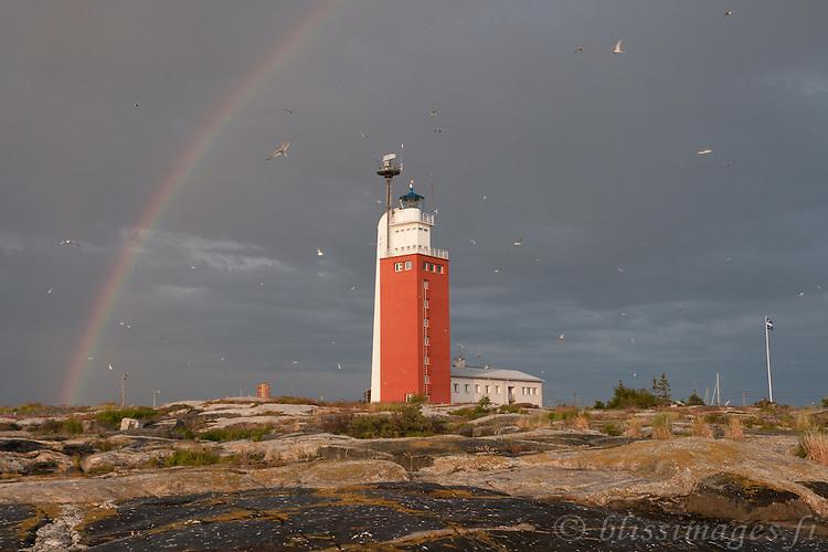 Seabirds fly over Kylmäpihlaja lighthouse & rainbow -western Finland