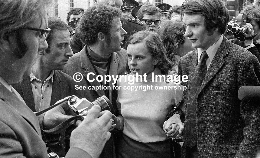 Bernadette Devlin, MP, in a media scrum outside the N Ireland High Court, after being refused leave to appeal to the Lords against a 6 months jail sentence for her part in rioting in the Bogside in Londonderry. Also in the photo is Eamonn McCann with a protective arm around Bernadette's shoulder. 197006260236c..Copyright Image from Victor Patterson, 54 Dorchester Park, Belfast, UK, BT9 6RJ..Tel: +44 28 9066 1296.Mob: +44 7802 353836.Voicemail +44 20 8816 7153.Skype: victorpattersonbelfast.Email: victorpatterson@mac.com.Email: victorpatterson@ireland.com (back-up)..IMPORTANT: If you wish to use this image or any other of my images please go to www.victorpatterson.com and click on the Terms & Conditions. Then contact me by email or phone with the reference number(s) of the image(s) concerned.