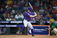 Daniel Cabrera (8) of the LSU Tigers at bat against the Baylor Bears in game five of the 2020 Shriners Hospitals for Children College Classic at Minute Maid Park on February 28, 2020 in Houston, Texas. The Bears defeated the Tigers 6-4. (Brian Westerholt/Four Seam Images)