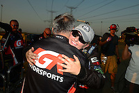 Jul. 1, 2012; Joliet, IL, USA: NHRA pro stock driver Erica Enders is congratulated by a crew member after winning her first career race at the Route 66 Nationals at Route 66 Raceway. Mandatory Credit: Mark J. Rebilas-