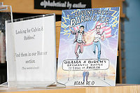 "A copy of the graphic novel ""The Adventures of Barry and Joe"" about Obama and Biden is seen on a book shelf as Democratic presidential candidate Pete Buttigieg speaks at a campaign event at Gibson's Bookstore in Concord, New Hampshire, USA, on Sat., Apr. 6, 2019. Buttigieg is the mayor of South Bend, Indiana, and was widely considered a long-shot candidate until his appearance in a CNN town hall in March 2019 which catapulted his campaign to prominence and substantial donations."