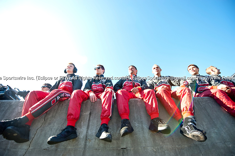 Audi engineers sit on the pitwall during the open grid walk for fans to mingle with the drivers and teams.