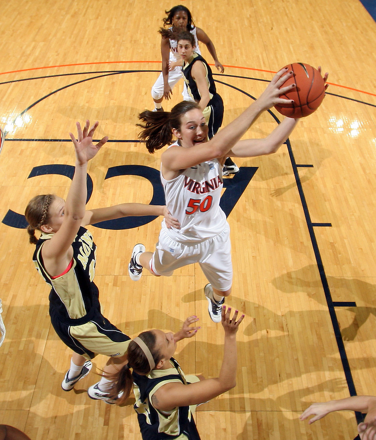 Nov. 14, 2010; Charlottesville, VA, USA; Virginia forward Chelsea Shine (50) passes the ball in front of Mount St. Mary's forward Mary Dunn (24) and Mount St. Mary's guard Syd Henderson (22) during the game at the John Paul Jones Arena. Virginia won 81-58. Mandatory Credit: Andrew Shurtleff