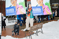 """Edward Kimmel, of Takoma Park, Maryland, holds banners he made using photos he took of Democratic presidential candidate and Massachusetts senator Elizabeth Warren before a campaign rally for the candidate at Rochester Opera House in Rochester, New Hampshire, on Mon., Feb. 10, 2020. The opposite side of one banner says """"Warren Whips Trump."""" This is the final day of campaigning before voting in the primary happens on Feb. 11. Warren has fallen to 4th or 5th place in recent polls."""