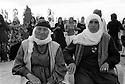 Turkey 2007 <br />At a wedding in Dogubayazit, old ladies sitting in armchairs with young women dancing in the background<br />Turkey 2007<br />Un mariage a Dogubayazit: Deux dames ag&eacute;es assises dans des fauteuils avec de jeunes femmes dansant a l&rsquo;arriere plan