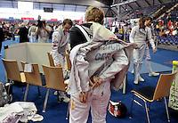 European Championships Fencing 2010 / Fecht Europameisterschaft 2010 in Leipzig - Competition Championat d'europe - in picture: The German mens foil team loses the match against Great Britian (45:41) - Peter Joppich puts off his jacket   . Foto: Norman Rembarz..Norman Rembarz , Autorennummer 41043728 , Augustenstr. 2, 04317 Leipzig, Tel.: 01794887569, Hypovereinsbank: BLZ: 86020086, KN: 357889472, St.Nr.: 231/261/06432 - Jegliche kommerzielle Nutzung ist honorar- und mehrwertsteuerpflichtig! Persönlichkeitsrechte sind zu wahren. Es wird keine Haftung übernommen bei Verletzung von Rechten Dritter. Autoren-Nennung gem. §13 UrhGes. wird verlangt. Weitergabe an Dritte nur nach  vorheriger Absprache..