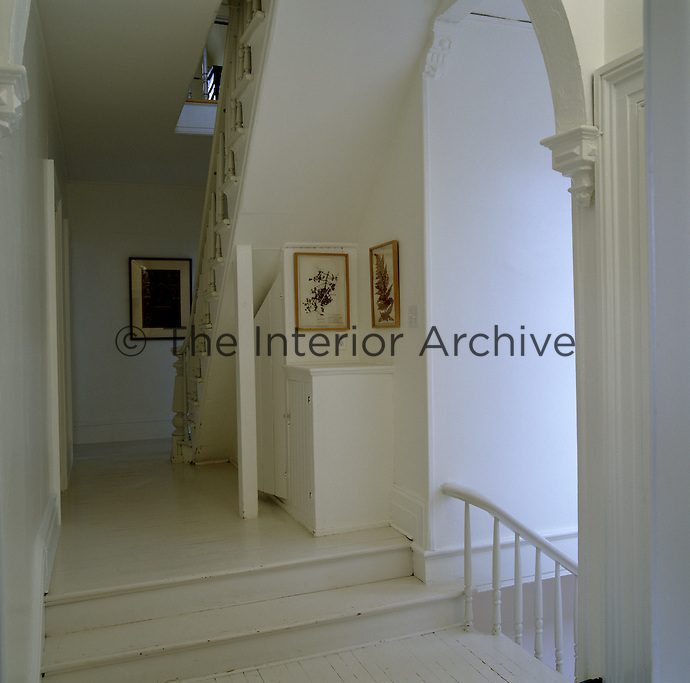 The floorboards and walls of the landing and staircase have been painted white