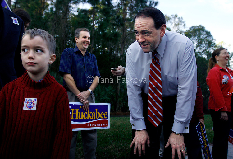 U.S. Presidential hopeful Mike Huckabee (R-AR) jokes around with five-year-old Luke Marks, from Tampa, Florida, by a polling site at the Westchase Swim and Tennis Center, where he stopped by to greet voters and potential supporters in Tampa, Florida, on the state's primary day, Tuesday, January 29, 2008. (Photo by: Yana Paskova for The New York Times)