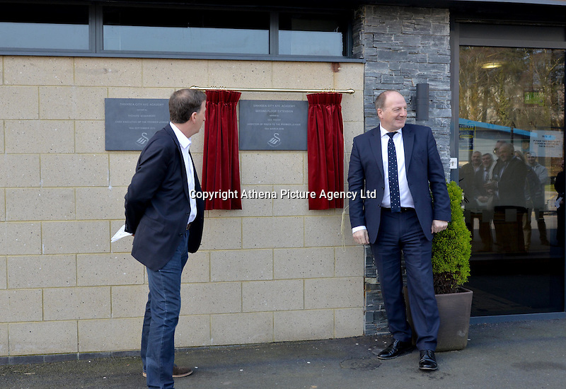 Friday 18th March 2016<br /> L-R Huw Jenkins and Ged Roddy of the Premier League unveiling the new facility plaque<br /> Official opening of the Swansea City Landore Academy which includes a 3rd floor classroom, an extension and an indoor training barn