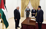 Mr. Adnan Salem Abu Wardah sworn in as a judge in the Constitutional Court in front of Palestinian President Mahmoud Abbas, in the West Bank city of Ramallah on June 13, 2019. Photo by Thaer Ganaim