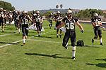 Palos Verdes, CA 09/09/11 - Chris Whitehead (Peninsula #36), Nathan Jo (Peninsula #12), Luke Morrow (Peninsula #33), Max McHugh (Peninsula #59) and Eric Dumas (Peninsula #27) in action during the North Torrance-Peninsula Panthers varsity football game.