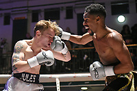 Fuad Fufu (black/gold shorts) defeats Jules Phillips during a Boxing Show at York Hall on 3rd March 2018